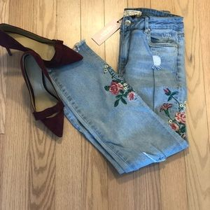Distressed embroidered jeans